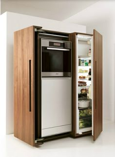 Kitchen appliances are discreetly concealed behind the doors of the bulthaup b2 appliance housing cabinet. Ovens, dishwashers and refrigerators can all be accommodated.