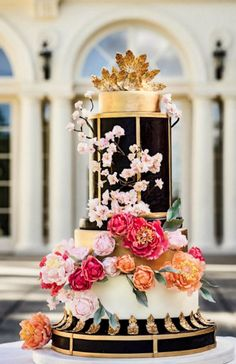 Uniquely glamorous gold and black wedding cake with colorful flowers; Featured Photographer: JAGstudios, Featured Cake: Ana Parzych Cakes