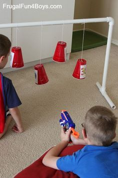 Swinging Nerf targets made from plastic cups- my kids played for hours