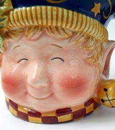 Susan Winget Coffee Mug Christmas Smiling Elf Face Checks Stars Nightcap Handle Certified International http://www.amazon.com/dp/B00VPR1VSM/ref=cm_sw_r_pi_dp_m8mvvb1DRCHNP