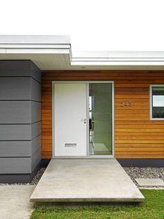 Cedar siding with fiber cement panels