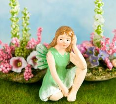 Mint Fairy Figurine  -  on sale $2.95  - Refresh your miniature displays with our dazzling green Miniature Mint Fairy. She is dressed in pleasing shades of mint green complete with a tiny sparkling pair of mint green fairy wings. Composed of durable detailed designer resin, our miniature fairy figurines are perfect for your miniature gardens and enchanted miniature displays.     Mint has long been a magical herb of the fairies used to ward off evil spirits and unwanted charms. Our little…