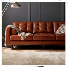 Black walls with this cool camel colored tuffed leather sofa from JCP. Super hard to find. Got it on sale too! Can't wait for it to arrive.