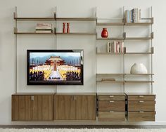 the as4 modular furniture system  Home theater with cabinets, decks, bookshelves and storage drawers.    Wood components in solid walnut.  Metal components in cold-rolled steel bar.
