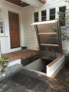 A secret hatch an ingenious entry point to the basement for Exterior basement access doors
