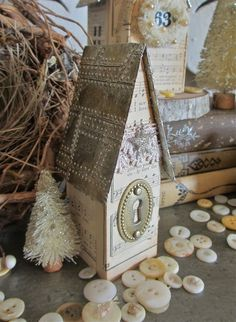 Tim Holtz Artful dwellings and vintage music paper with embossed foil roof.