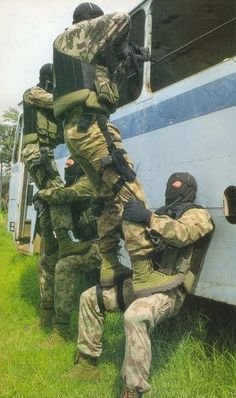 Task Force members with HK submachine guns in a Bus Assault Exercise.