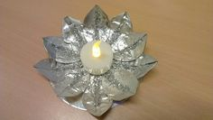 Made from waxine light cups and an old CD