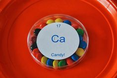 """petri dishes filled with candy and labeled with a fake """"element"""" from the periodic table"""