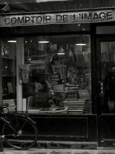 Comptoir de l'Image  44 rue de Sévigné, 3e, Marais, Paris, 75003 (from the Sartorialist) ..my idea of heaven on a rainy day too....!