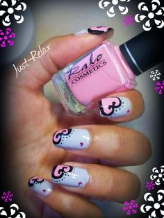 A blue grey backround with pink and black hearts.