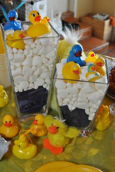 Blue tissue paper, marshmallows and bath ducks to create easy and inexpensive duck baby shower centerpieces