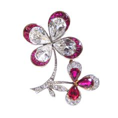 A Ruby and Diamond 'Lucky in Love' Brooch, in the form of a four-leaf clover.  Pear-shaped diamonds with ruby tips, brilliant cut and marquise diamonds on the platinum stems.  French, circa 1910