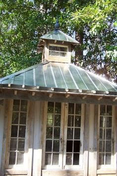 Old architectural salvaged doors make the most charming outdoor rooms or potting sheds