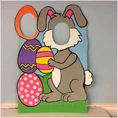 This Easter Bunny photo prop is perfect for any Easter or Spring inspired event, birthday, or holiday Party.  This Double face hole cutout is