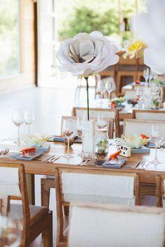 oversized paper flower centerpiece! photo by Dearheart Photos http://ruffledblog.com/old-mac-daddy-wedding #weddingideas #centerpieces #paperflowers