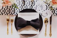Black Bow napkin, art deco inspired black and white table cloth, gold cutlery and a hint of feminine pink makes an elegant wedding table setting.. | From Bklyn Bride Online