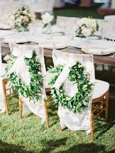 Lush green garlands look lovely atop lace chair covers. Wedding Decorations, Wedding Chairs, Bride and Groom Chairs Wedding Chair Decorations, Wedding Chairs, Decoration Table, Wedding Table, Wedding Receptions, Reception Ideas, Greenery Wreath, Wreaths, Flower Studio