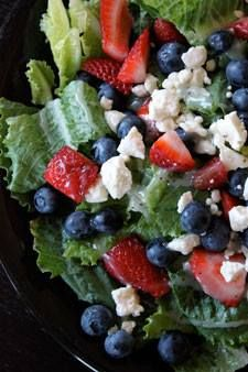 Celebrate the 4th of July with this healthy salad! 3-4 cups of fresh romaine lettuce cleaned and torn (you could just use the bagged stuff). About 1/2 cup fresh blueberries. About 1/2 cup fresh strawberries cut in small chunks. 1 oz (28g) Crumbled Feta. Top with your favorite low sugar dressing. And, you can always add grilled chicken for some protein!