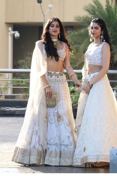 Spotted: The dynamic duo of sisters and look pristinely pure dressed in white ensembles for wedding to ✨ Shop this look at Carma by sending us a screenshot at Indian Attire, Indian Ethnic Wear, Indian Wedding Outfits, Indian Outfits, Wedding Dresses, Bridal Lehenga, Lehenga Choli, Lehenga White, Bollywood Lehenga