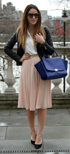 Blue bag with a peach pleated skirt and black jacket | Street Style