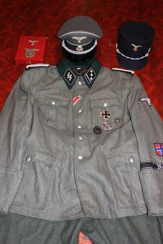 This covers the American and Allied uniforms used in WWII, and Korea and the Vietnam War found in the Mark Stone collection. Ww2 Uniforms, German Uniforms, Military Uniforms, German Soldiers Ww2, German Army, Army Ranks, Black Tunic, Vietnam War, World War Ii