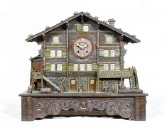 Swiss cuckoo clock in the shape of a Brienz chalet. Brienz (Switzerland, ca. 1900). Carved and painted wood.