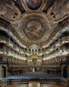 David Leventi photographs the interiors of world famous opera houses, capturing the ornate design of the architecture found inside. Using 4×5″ and 8×10″ Arca-Swiss cameras, Leventi captures each opera house from the vantage of an operatic singer, photographing the space from the very center of the stage.