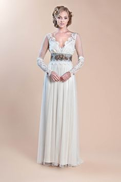 Vintage dreams come to life with the Abbey wedding dress. This ivory cotton…
