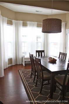 How to hang curtains in a bay window using inexpensive IKEA hardware and curtain panels.