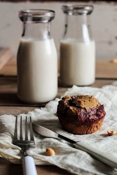 peanut butter & jelly muffins. an adult twist on a childhood favorite.  made with whole wheat flour and flax meal with grape jelly in the center! | pastry affair
