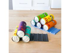 The Fridge Monkey is a simple, flexible rubber mat designed to help clear up the clutter in your fridge by stacking bottles and cans into a pyramid - it's cleve