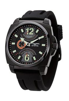 The Jorg Gray JG1040-18 Men's Watch is a retrograde watch with dual time and date. The watch has a black dial with green hour markers on a black stainless steel case and 50 meters of water resistance.