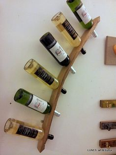 Wall mounted oak wine rack from recycled French wine by Lunes, €32.00