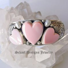 Pink conch shell, white freshwater pearls, & sterling silver hearts cuff bracelet | Schaef Designs  | New Mexico