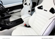 Sports seats with Lotus White leather and contrast black detailing for the driver and front passenger.