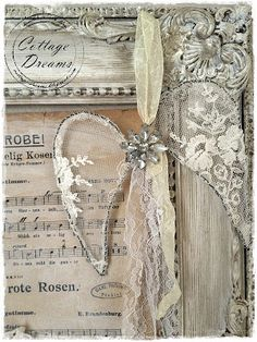 Love the lace angel wings - stretched over wire frame with #vintage jewelry brooch in center - hung from #lace or muslin ribbon - set off perfectly in the distressed white frame - with a framed hymn this would be wonderful! from Cottage Dreams: Mehr Weihnachtskram