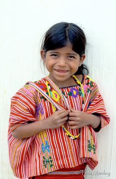 GUATEMALA, GRANADILLO: Young seven-year-old Mam girl wearing traditional handwoven huipil and corte at a medical clinic in the northwestern highlands of Guatemala.