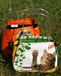 Catfood and dogfood bags - romping in the grass.