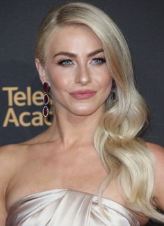 Julianne Hough styled her dress with classic Hollywood side-swept waves, soft pink lips, and Dvani ruby earrings