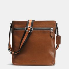 Finely crafted in smooth leather with a sporty canvas strap, the Metropolitan Crossbody combines luxe materials with functional features. The wearable design has a well-organized interior with pockets for tech items and other essentials.