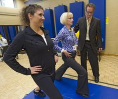 Dr. Bruce Crawford, far right, a urogynecologist from Nevada, watches while Jody Strik, manager of Work Fit Total Therapy Centre,  left, and Christina Daly, physiotherapist, demonstrate a lunging exercise. Crawford created Pfilates, exercises that strengthen the pelvic floor muscles to combat disorders such as incontinence. - BERNARD WEIL/Toronto Star