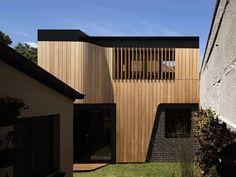 Pivot Transforms a Boring Suburban Building into a Gorgeous Cedar and Brick Art Studio