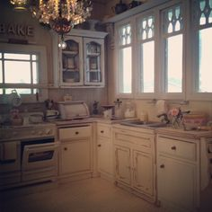 I picture the ocean outside the windows. 1:12 scale dollhouse miniature kitchen