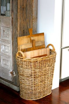 Cutting board storage in a basket by a rustic cabinet. the Polished Pebble: Kitchen design flaws: simple solutions Cutting Board Storage, Large Cutting Board, Cutting Boards, Chopping Boards, Wood Cutting, Kitchen Organization, Kitchen Storage, Kitchen Decor, Organization Ideas