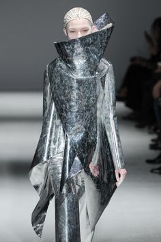 Sculptural Fashion with dramatic draped silhouette using metallic mirrored fabric; futuristic fashion // Gareth Pugh