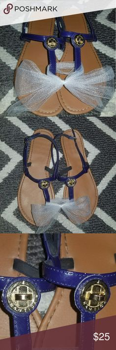 Nautical Thong Sandals Really cute,  gently used,  Nautical thong flat sandals.  Navy blue and tan with gold hardware.    *There is a small scuff on the toe of the sandal. Nautica Shoes Sandals