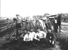 HOBBIES: Young men with Penny-Farthing bicycles and rough road in Tallahassee, Florida, 1900