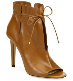 """Memphis 100 cinched leather peep-toe booties by Jimmy Choo. Slit leather peep-toe booties cinched at the ankleSelf-covered heel, 4"""" (100mm)Leather upperPeep ..."""