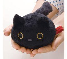 round black Kutusita Nyanko cat plush toy